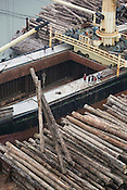 Turama Forest Industries load illegally cut trees from barges onto the 'Harbour Gemini' cargo ship, in Paia Port, in the 'Turama extension' logging concession, Gulf Province, Papua New Guinea, Saturday 6th September 2008.These forests are being felled by Turama Forest Industries - a group company of Malayasian logging giant Rimbunan Hijau. Twenty percent of global greenhouse emissions annually are caused by the deforestation of natural forests worldwide.