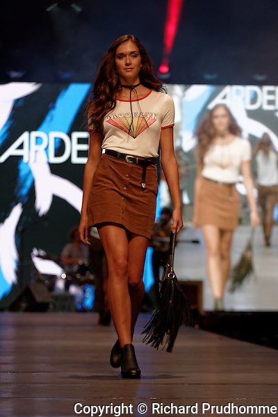 A model walks on the runway at the Ardene fashion show held during the Fashion and Design Festival  in downtown Montreal, Quebec.