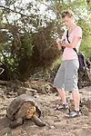 Charles Darwin Research Station, Puerto Ayora, Santa Cruz Island, Galapagos, Ecuador; Galapagos Giant Tortoise (Geochelone elephantopus) from Espanola Island being photographed by a tourist , Copyright © Matthew Meier, matthewmeierphoto.com All Rights Reserved