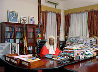 Chief Justice Benjamin J. Odoki in his office. Like other judges, he has been appointed by the President with the approval of Parliament.