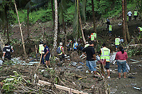 Police officers and volunteers search the Aleipata coast, that bore the full force of the tsunami. More than 170 people died when a tsunami triggered by an 8.3 magnitude earthquake hit Samoa and neighbouring Pacific islands on 29/09/2009. Samoa (formerly known as Western Samoa)..