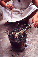 In such a temperate climate outdoor cooking keeps the smoke out of the living quarters. Cambodia. Pentax Spotmatic. 2004
