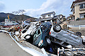 April 2nd, 2011, Ofunato, Japan - A canal is clogged by a heap of motor vehicles as a washed-away fishing boat sits in the background in Ofunato City, Iwate Prefecture, on April 2, 2011, three weeks after this northeastern Japanese fishing port nestled deep inside an inlet was destroyed by a magnitude 9.0 earthquake and ensuing tsunami. (Photo by Natsuki Sakai/AFLO) [3615] -mis-...