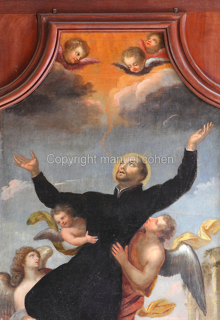 Painting of the Celestial Glory of St Ignatius of Loyola, 1491-1556, founder of the Society of Jesus or Jesuit Order, depicting his glorious ascent to Heaven after his death, by Jean Helart, 1618-85, French painter, in the wooden panelling of the refectory of the Ancien College des Jesuites or Former Jesuit College in Reims, Marne, Champagne-Ardenne, France. The College was built 1619-78 and is now the Euro-American campus of Sciences Po, or the Institut d'Etudes politiques de Paris, and the FRAC Champagne-Ardenne. It is listed as a historic monument. Picture by Manuel Cohen