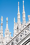 Statues carved on the spires on the roof of the Duomo (Cathedral) in Milan, Italy. The rooftop of the Duomo in Milan, Italy.