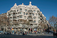 Full Façade on Provenza street and Paseo de Gracia; Gaudi standing lamps with bench on Paseo de Garcia, La Pedrera (Casa Milà), Barcelona, Catalonia, Spain, built by Antoni Gaudí (Reus 1852 ? Barcelona 1926), 1906 - 1910, for the Milà Family, with Josep Maria Jujol as architect collaborator and with Joan Beltran as a plaster. One of the main Gaudi residential buildings. Picture by Manuel Cohen