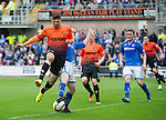 Dundee United v St Johnstone...24.08.13      SPFL<br /> Nadir Ciftci is tackled by Steven Anderson<br /> Picture by Graeme Hart.<br /> Copyright Perthshire Picture Agency<br /> Tel: 01738 623350  Mobile: 07990 594431