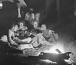 North East PA: Aunt Margaret Gray leading the Stewart family in song around the campfire.  Brady Stewart is throwing flash power on the campfire to create an image - 1904.  During the early 1900s, the Stewart family vacationed on Lake Erie near North East Pennsylvania. Since hotels and motels were non-existent, camping was the only viable option for a large number of vacationers.