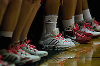 Girls basketball team wears pink shoelaces in honor of Breast Cancer awareness week.