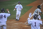 Ole Miss' Matt Smith (16) scores on a Matt Tracy single in the 8th inning against Tulane at Oxford-University Stadium in Oxford, Miss. on Friday, March 4, 2010.  Ole Miss won 5-1 to improve to 10-1.