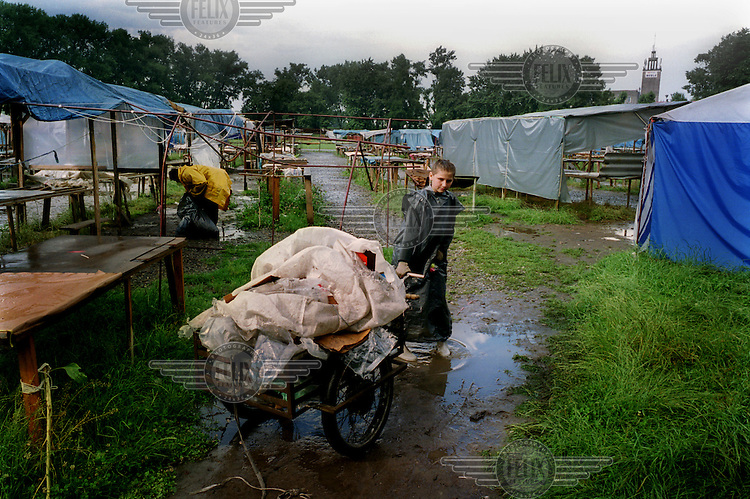 A Ukranian child in the deserted market in Przemysl. This market used to stay open until at least 8pm. As the Polish restrictions on the border take effect, the market now closes at around 4 pm due to lack of business.