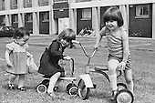 Kids playing, Wester Hailes, Scotland, 1979.  John Walmsley was Photographer in Residence at the Education Centre for three weeks in 1979.  The Education Centre was, at the time, Scotland's largest purpose built community High School open all day every day for all ages from primary to adults.  The town of Wester Hailes, a few miles to the south west of Edinburgh, was built in the early 1970s mostly of blocks of flats and high rises.