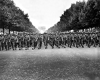 American troops of the 28th Infantry Division march down the Champs Elysees, Paris, in the &quot;Victory&quot; Parade.  August 29, 1944.  Poinsett. (Army)<br /> NARA FILE #:  111-SC-193197<br /> WAR &amp; CONFLICT BOOK #:  1059