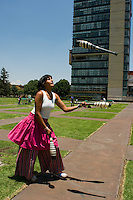 A student learns to juggle at the Mexico City campus (Ciudad Universitario) of the UNAM (Universidad Autonomo de Mexico) Mexico City. June 20, 2008