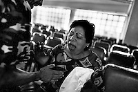 A Mexican woman womits during the exorcism ritual performed at the Church of the Divine Saviour in of Mexico City, Mexico, 31 May 2011. Exorcism is an ancient religious technique of evicting spirits, generally called demons or evil, from a person which is believed to be possessed. Although the formal catholic rite of exorcism is rarely seen and must be only conducted by a designated priest, there are many Christian pastors and preachers (known as 'exorcistas') performing exorcism and prayers of liberation. Using their strong charisma, special skills and religous formulas, they command the evil spirit to depart a victim's mind and body, usually invoking Jesus Christ or God to intervene in favour of a possessed person.