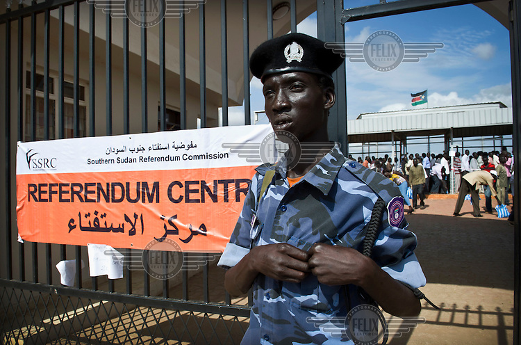 A policeman leaves a referendum centre in Juba after receiving his registration card for the January 2011 election when the people of South Sudan will vote in a referendum on independence.