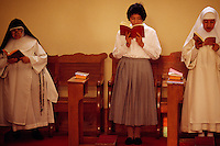 Songs and prayer are how nuns begin their day at Santa Catalina Convent in Arequipa, Peru. The Monasterio de Santa Catalina was built in 1580. Among the 30 cloistered nuns who live in privacy in the convent are five novicias who have to study for five years to become a nun. The youngest nun is 15. The oldest is 98.
