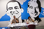 Victor Motley, left, and Sharyn Kenchen, volunteers with Organizing for America, President Obama's re-election campaign arm, make phone calls to potential supporters in the group's Richmond headquarters on Thursday, May 3, 2012 in Richmond, VA.