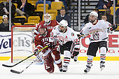 Alex Biega (Harvard - 3), Greg Costa (NU - 22), Robbie Vrolyk (NU - 91) - The Northeastern University Huskies defeated the Harvard University Crimson 4-1 (EN) on Monday, February 8, 2010, at the TD Garden in Boston, Massachusetts, in the 2010 Beanpot consolation game.
