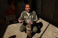 Gaza, Palestine.  Farmer, Saad El Atar, shows the case of a missile fired on his house -out of seven- by the Israeli army during the s military campaign inside Gaza, known as Operation Cast lead.  Saad lost his house and the israeli army took his newlywed son Hassan El Atar, 24. prisioner with out charges until this moment. He is known to be detained in the Ashkalon prision. The conflict resulted in between 1,166 and 1,417 Palestinian and 13 Israeli deaths (4 from friendly fire).   (PHOTO: MIGUEL JUAREZ LUGO)