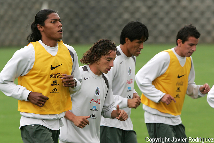 Mexico national soccer team players Joel Huiqui (L-R), Andres Guardado, Claudio Suarez and Mario Mendez  run during a training session at the Centro Pegaso training center, March 27, 2006. Photo by Javier Rodriguez