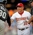 16 August 2008: Washington Nationals' third base coach Tim Tolman exchanges lineup cards at home plate prior to a game against the Colorado Rockies at Nationals Park in Washington, DC.  The Rockies defeated the Nationals 13-6, handing the last place Nationals their 9th consecutive loss. ..Mandatory Photo Credit: Ed Wolfstein Photo