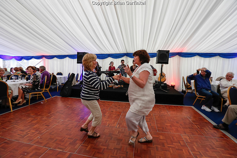 Maryann and Marie dance in the tent at the Caulfield home  in Granlahan, County Roscommon, Ireland on Tuesday, June 25th 2013. (Photo by Brian Garfinkel)