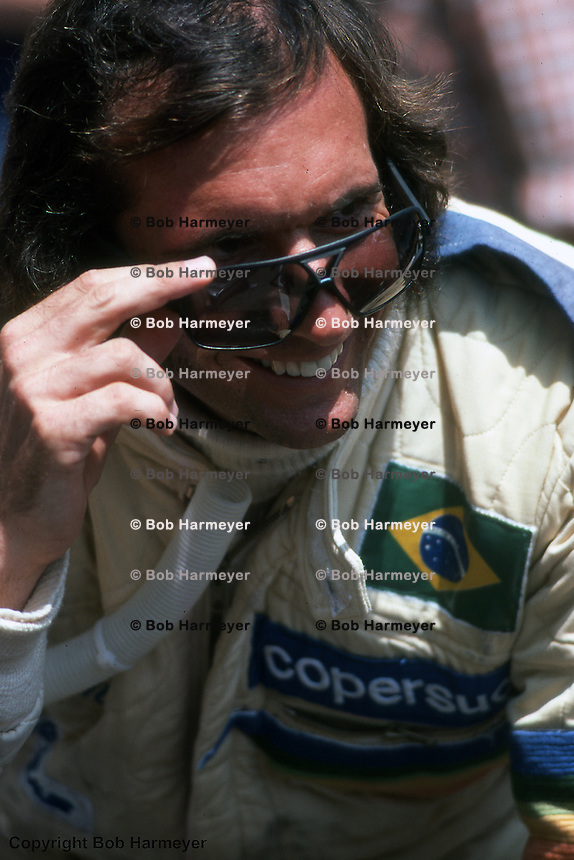 MONTE CARLO - MAY 30: Emerson Fittipaldi in the pit lane before practice for the 1976 Monaco Grand Prix on May 30, 1976, at the Circuit de Monaco in Monte Carlo, Monaco.