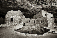 Sepia toned image of a kiva and ruins at the Cliff Palace House in Mesa Verde Natinal Park in southwestern Colorado.