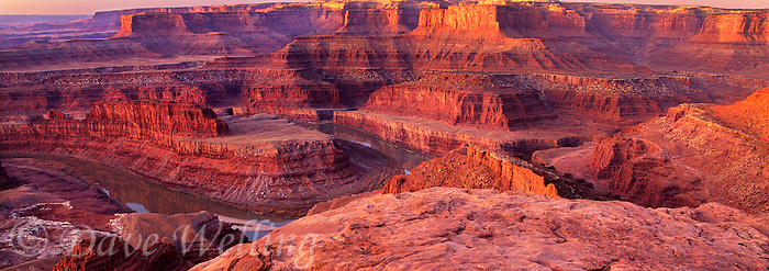 988000024 panoramic view of sunrise over the colorado river and the sandstone formations from lookout dead horse point state park utah