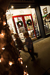 Children scurry by a shop in downtown Los Altos during First Friday Dec. 7.
