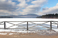 A vivid view of Mount Chocoura from the Old Chocorua Lake Bridge (prior to its replacement). Ice and fresh snow cover Chocorua Lake.