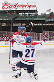 Joseph Pendenza (UML - 14), Zack Kamrass (UML - 27) - The Northeastern University Huskies defeated the University of Massachusetts Lowell River Hawks 4-1 (EN) on Saturday, January 11, 2014, at Fenway Park in Boston, Massachusetts.
