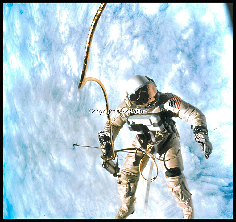 BNPS.co.uk (01202 558833)<br /> Pic: Bonhams/BNPS<br /> <br /> *Please use full byline*<br /> <br /> A photograph of Edward White during the EVA taken by James McDivitt.<br /> <br /> A bloodstained document revealing a life-or-death episode that could have jettisoned the whole US space programme of the 1960s is tipped to sell for an astronomical &pound;80,000.<br /> <br /> The complete 13 page checklist was for the very first spacewalk undertaken by man in 1965 and documents a dramatic incident in which the astronauts struggled to close the hatch of their spacecraft afterwards.<br /> <br /> It is being sold by Bonhams in New York later this month.