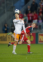 07 May2011: Houston Dynamo defender Andre Hainault #31 and Toronto FC forward Nick Soolsma #18 in action during an MLS game between the Houston Dynamo and the Toronto FC at BMO Field in Toronto, Ontario..Toronto FC won 2-1.