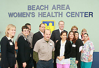 San Diego Councilmember for District 2, Kevin Faulconer poses for a photograph with the staff of the new  Beach Area Women's Health Center in Mission Beach San Diego December 6  2007.