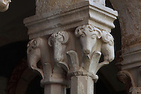 Capital with sheep heads, atop pairs of 8-sided columns in the colonnade of the Cloister, built in late Romanesque style by Mihoje Brajkov of Bar in 1360, at the Franciscan monastery on Stradun or Placa, Old Town, Dubrovnik, Croatia. The city developed as an important port in the 15th and 16th centuries and has had a multicultural history, allied to the Romans, Ostrogoths, Byzantines, Ancona, Hungary and the Ottomans. In 1979 the city was listed as a UNESCO World Heritage Site. Picture by Manuel Cohen