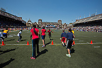 Fifth graders from Philadelphia public schools compete in the shuttle relay on the infield of Franklin Field on Friday at the Penn Relays.