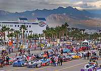 Oct 28, 2016; Las Vegas, NV, USA; NHRA super gas drivers wait in the staging lanes as mountains are visible in the background during qualifying for the Toyota Nationals at The Strip at Las Vegas Motor Speedway. Mandatory Credit: Mark J. Rebilas-USA TODAY Sports