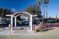 A child's bike sits in front of the pergola at Circle Park, a pocket park in Anaheim, CA.