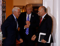 Andrew Puzder (R), chief executive of CKE Restaurants, leaves the clubhouse of Trump International Golf Club, after meeting with United States President-elect Donald Trump (C) and Vice President-elect Mike Pence (L), November 19, 2016 in Bedminster Township, New Jersey. <br /> Credit: Aude Guerrucci / Pool via CNP /MediaPunch