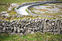 Stone walls, Inis Mór, Aaran Islands, County Galway, Ireland..The island of Inis Mór ( meaning the big island) is one of the most popular tourist destinations in Ireland. The islands inland landscape of uniquely blanketed rock surface are glazed with man made rock walls that meander and cross all directions as far as one can see. Well known internationally, it is steeped in history and resembles an outdoor museum with over 50 different monuments of Christian, pre Christian and Celtic mythological heritage. Picture James Horan