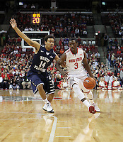 Ohio State's Shannon Scott (3) drives to the basket as North Florida's Dallas Moore (14) defends during the first half Friday, Nov. 29, 2013, in Columbus, Ohio. (Photo by Terry Gilliam)