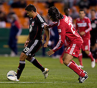 Wilman Conde (22) of the Chicago Fire moves in on Jaime Moreno (99) of DC United at RFK Stadium in Washington, DC.  The Chicago Fire defeated DC United, 2-0.