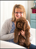BNPS.co.uk (01202 558833)<br /> Pic: PhilYeomans/BNPS<br /> <br /> Van Bennett's with her Sussex Spaniel puppy Beryl.<br /> <br /> Whisper it quietly...but this puppy could be a lifeline for one of Britains rarest native dog breeds.Only 49 Sussex Spaniels were registered last year with the kennel club - making the ancient British breed rarer than White Rhino's, Tigers or even Giant Panda's. <br /> <br /> Plucky British dog breeds like these adorable Skye Terriers, Sussex Spaniels and Otterhounds are more endangered than the Giant Panda due to the modern infatuation with fashionable crossbreeds and foreign invaders.<br /> <br /> The unprecedented rise in popularity of 'handbag dogs' has put many traditional breeds on the brink of extinction. <br /> <br /> The bottom three in last years KC figures are Skye Terriers(28), Otterhounds(40) and Sussex Spaniels(49) making these adorable puppies a vital lifeline for their historic breeds - by contrast over 20,000 French Bulldog's were registered in 2016.