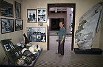 A visitor looks over a display of captured American helmets and uniforms in Hanoi's Armed Forces Military Museum which houses treasured war trophies from the French and American wars, along with many from the Cambodian and Chinese fronts.  (Jim Bryant Photo).....