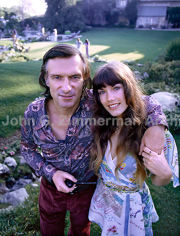 Hugh Hefner with girlfriend Barbi Benton at the Playboy Mansion, Los Angeles, 1973. Photo by John G. Zimmerman.