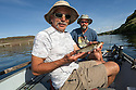 WA11792-00...WASHINGTON - Jim Johansen and Phil Russell fishing the Snake River near Lyons Ferry. Phil is holding a cat fish. (MR# J5 - R8)