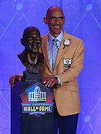 Canton, OH - August 6, 2016: Former NFL coach Tony Dungy poses with his bust during the Pro Football Hall of Fame Ensrinement Ceremony in Canton, Ohio, August 6, 2016. Dungy served 13 seasons as a NFL coach and was the first black coach ever to win a Super Bowl. (Photo by Don Baxter/Media Images International)