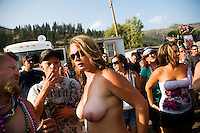 Contestants and crowd get ready for the wet t-shirt contest at the Testicle Festival at the Rock Creek Lodge in Clinton, MT.  Most contestants in the wet t-shirt contestants removed all of their clothing during the competition. The Rock Creek Lodge in Clinton, MT, has hosted the annual Testicle Festival since the early 1980s.  The four day festival and party revolves around the consumption of so-called Rocky Mountain Oysters, which are deep-fried bull testicles.